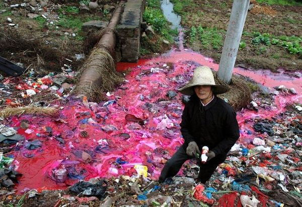 Besides trash, this river is also polluted with red dye.