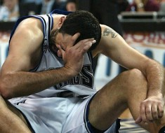 SACRAMENTO, CA - JUNE 2:  Vlade Divac of the Sacramento Kings sits on the floor after being fouled in the first half of game seven of the NBA Western Conference Finals against the Los Angeles Lakers, 02 June 2002, at ARCO Arena in Sacramento, CA. The Lakers won 112-106 in overtime to face the New Jersey Nets in the NBA Finals.  (Photo credit should read JOHN MABANGLO/AFP/Getty Images)