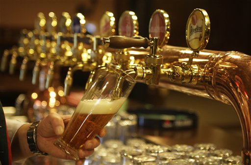 A bartender pours a glass of beer at a restaurant in the Pilsner Urquell factory in Pilsen, Czech Republic, Sunday, March 29, 2009. The faintly bitter lager first produced in the Pilsner Urquell factory more than a century ago gave rise to a style of beer that has since circled the globe. Much of today's lager-style beer, in fact, owes its flaxen color and crisp flavor to a brewing process formulated in this small metropolis in the Czech Republic's Bohemia region. Its name still reflects its origins: Pilsner, Pilsener, or sometimes just Pils. (AP Photo/Petr David Josek)