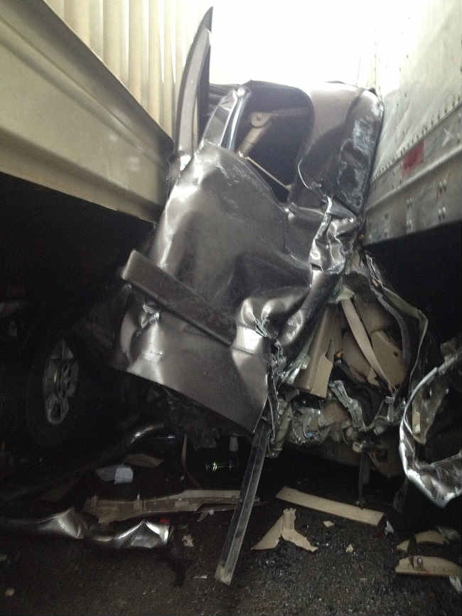 Oregon Man's Car Crushed Between Two Semis and He Miraculously