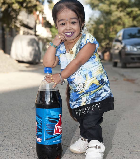 "Jyoti Amge used to be the shortest female teenager in the world, until she turned 18 and became the shortest woman in the world. Standing at 2 ft and a half inch, Jyoti has achieved worldwide fame as a result of her condition. Her short stature is a result of achondroplasia, one of the main causes of dwarfism. Jyoti's fame earned her a role on the 4th season of TV show, American Horror Story, where she played ""Ma Petite."""